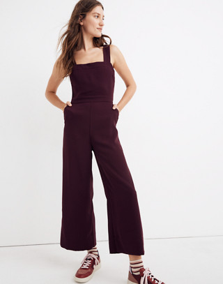 Apron Bow-Back Jumpsuit in rich plum image 1