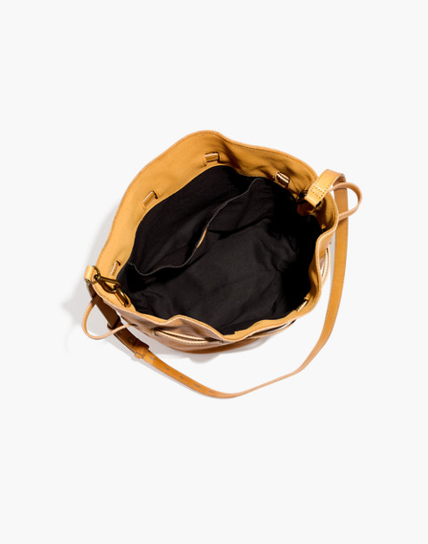 The Florence Drawstring Bucket Bag in Leather in raw amber image 2