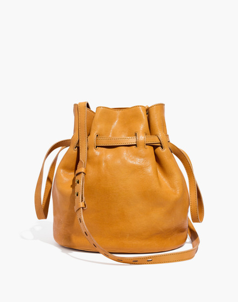 The Florence Drawstring Bucket Bag in Leather in raw amber image 1