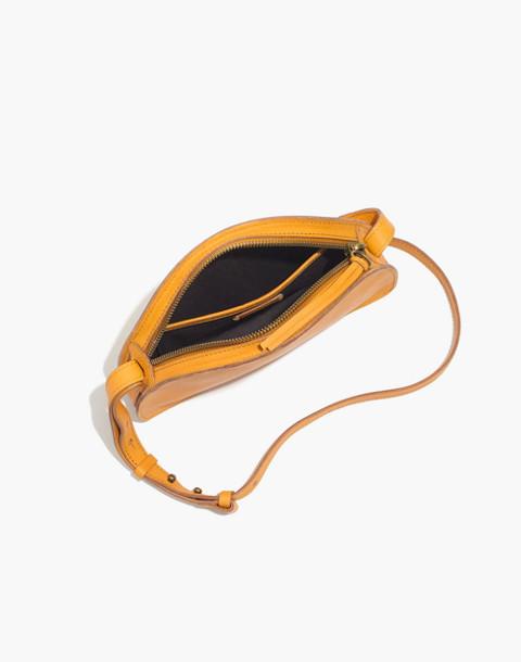 The Simple Half-Moon Crossbody Bag in raw amber image 2