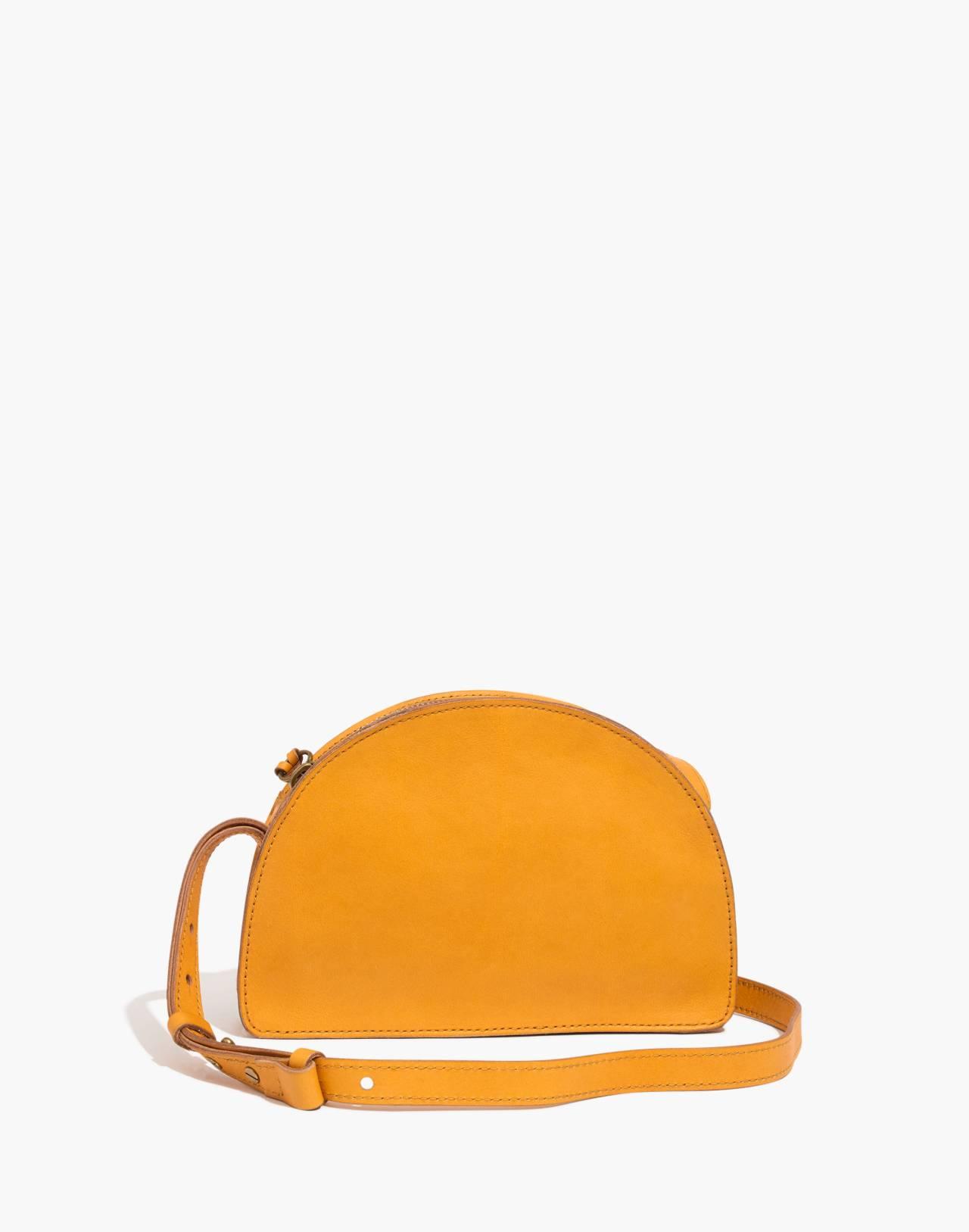 The Simple Half-Moon Crossbody Bag in raw amber image 1