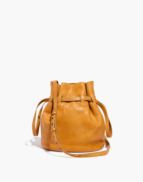 The Florence Drawstring Crossbody Bag in Leather in raw amber image 1