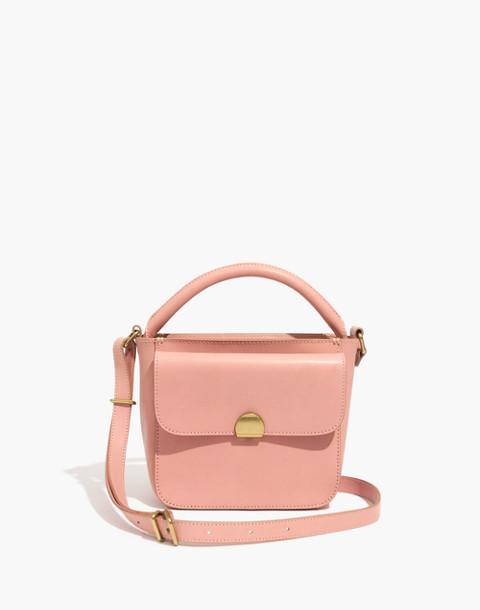 The Mini Abroad Crossbody Bag in peach image 1